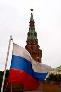 Russia flag with Kremlin in background